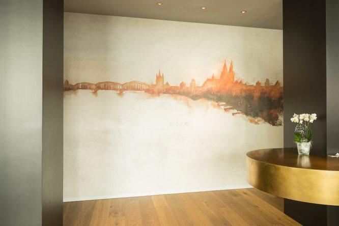 Wandgestaltung im Restaurant Maximilian Lorenz - Skyline von Köln
