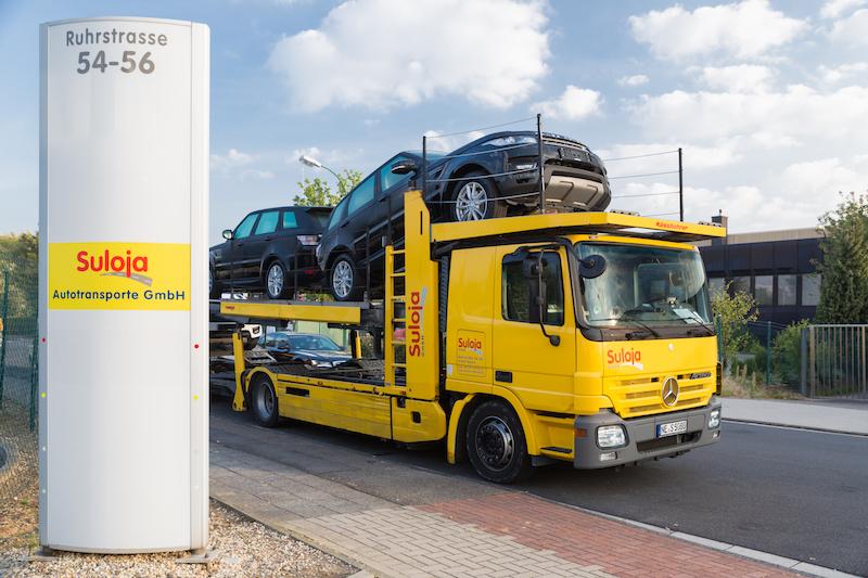 Suloja Autotransporte - Transporter und Firmenschild