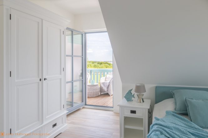 Ferienhaus Nautilus am Rügenblick21 - Schlafzimmer mit Meerblick